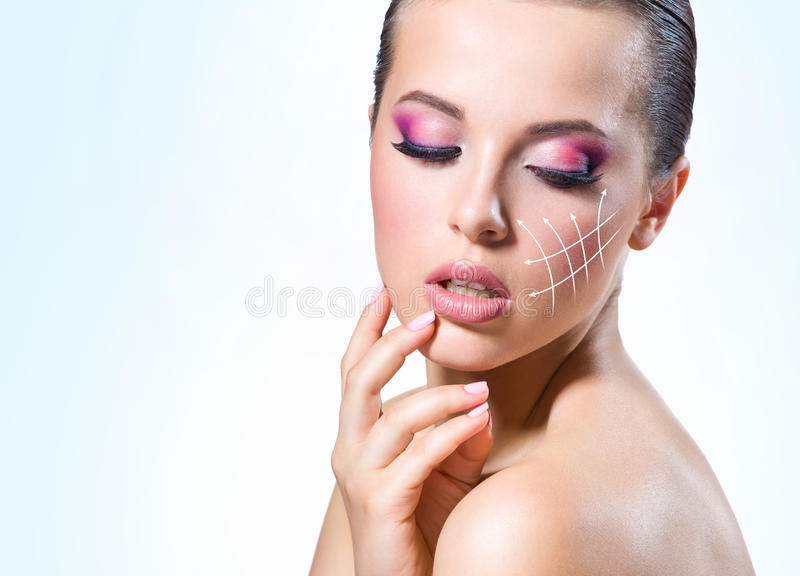 Massage lines on the girl face stock photo