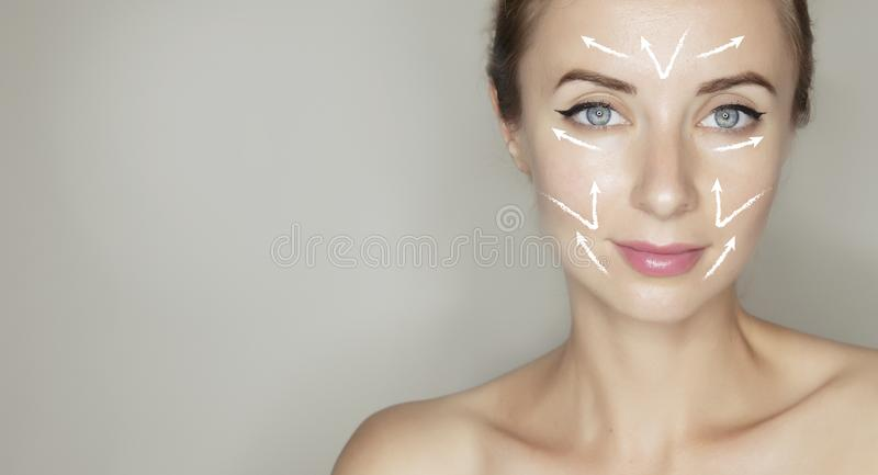 Massage lines on womans face. Woman face massage therapy old wrinkled skin. Template for design banner with copy space stock images