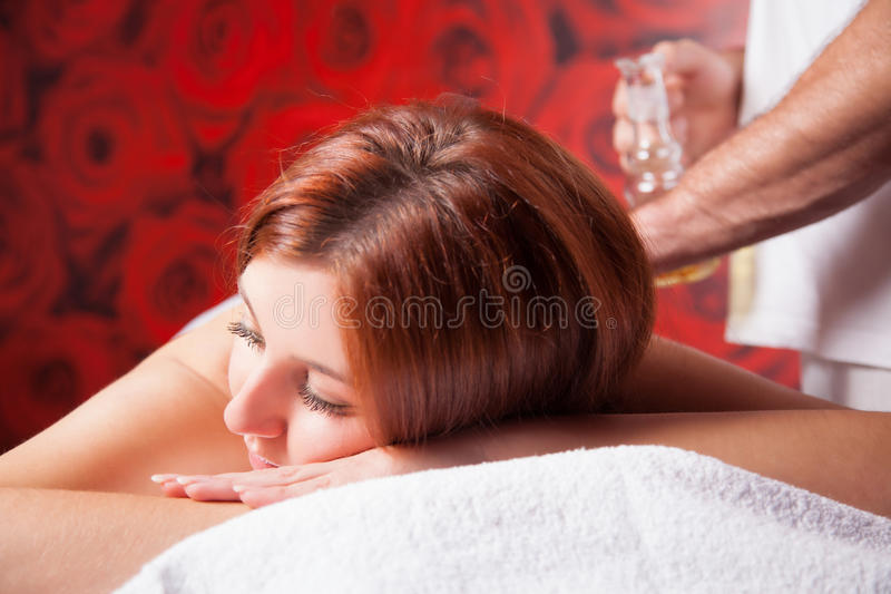 Massage with oil stock photography