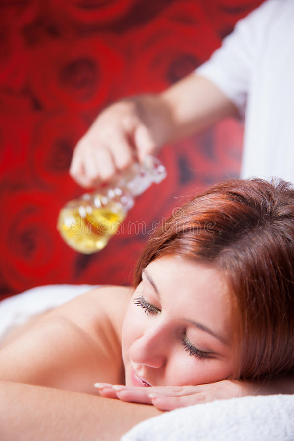 Massage with oil stock image