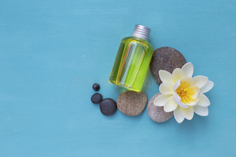 Massage oil bottle with white flower and round stone stock photo download massage oil bottle with white flower and round stone stock photo image of nature mightylinksfo