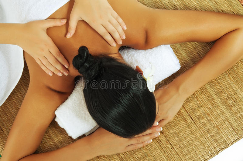 Massage. Portrait of young beautiful woman on color back stock images