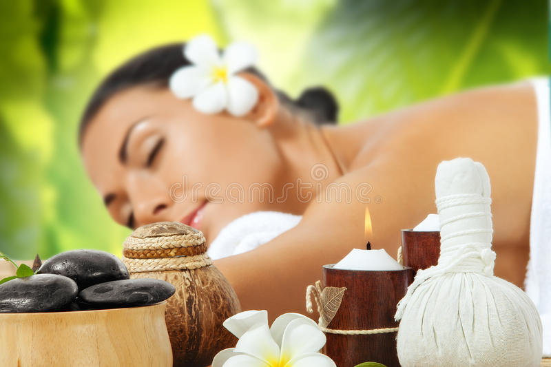 Massage. Portrait of young beautiful woman on color back royalty free stock photography