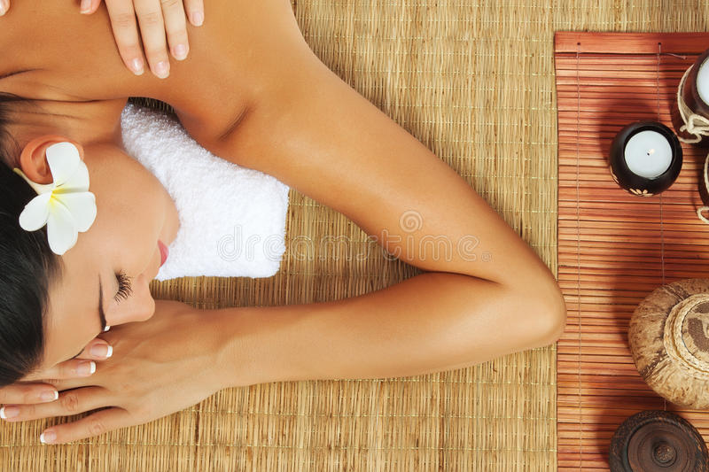 Massage. Portrait of young beautiful woman on color back stock photos
