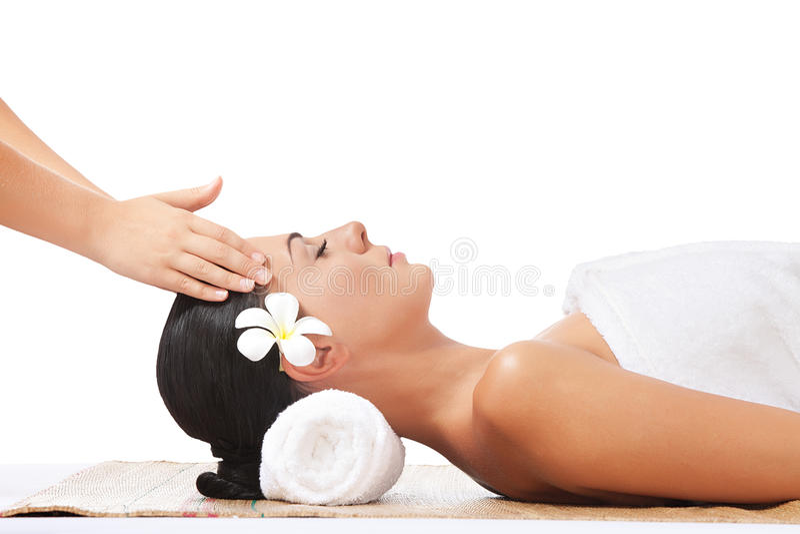 Massage. Portrait of young beautiful woman on white back royalty free stock photo