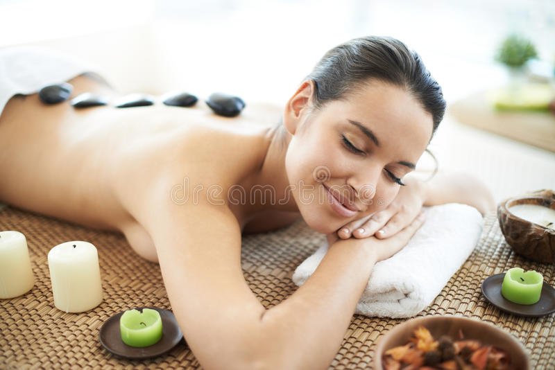 Before massage. Portrait of young female ready for the procedure of massage royalty free stock images