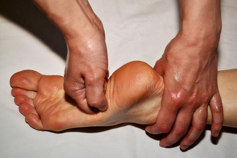Massage of the right foot stock image