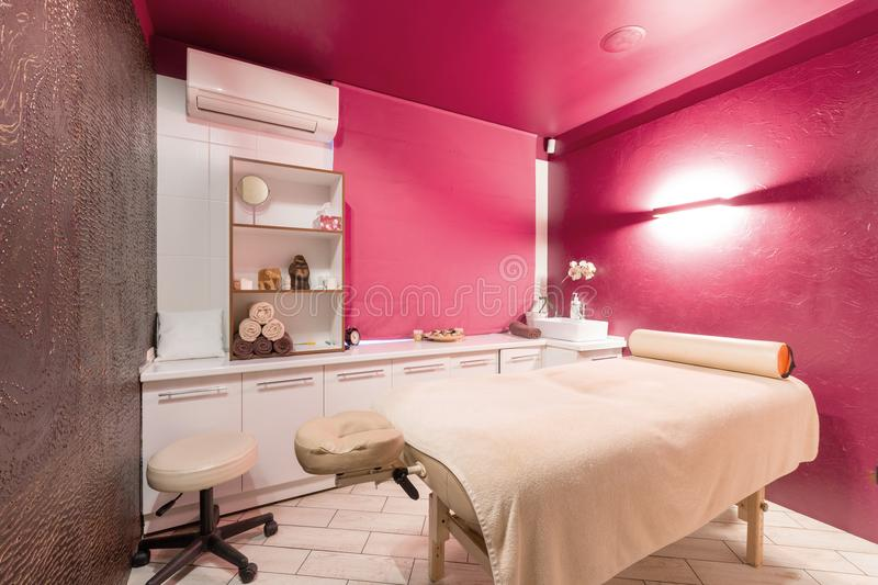 Massage room interior design in wellness and spa center. Dim lighting stock image