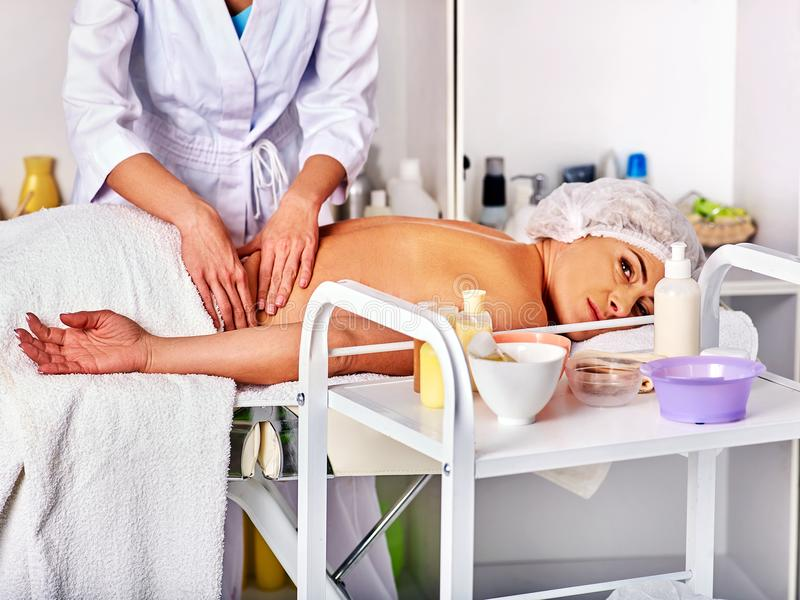 Massage therapy deals. Woman therapist making manual therapy back. Massage room for therapy deals. Woman therapist making manual therapy back. Hands of masseuse royalty free stock images