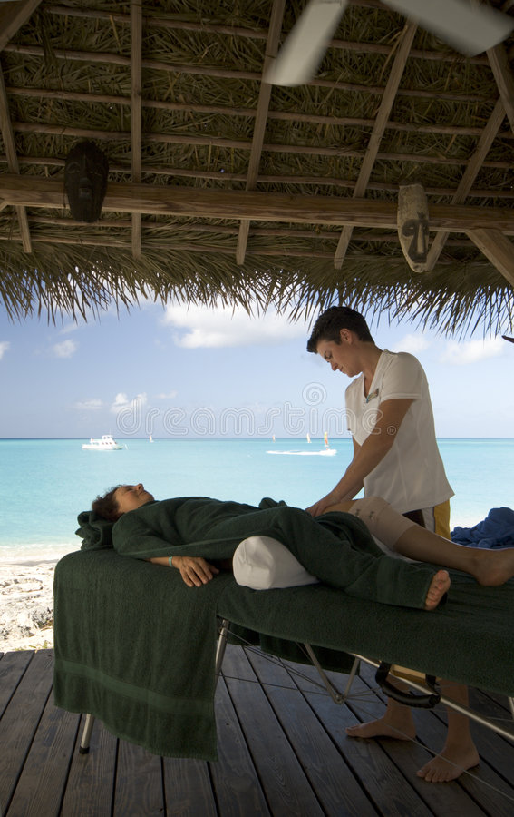 Massage by the sea royalty free stock photography