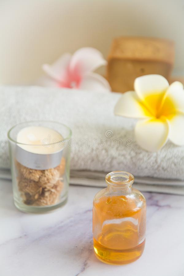 Massage set with Cinnamon essential oil massage royalty free stock photo
