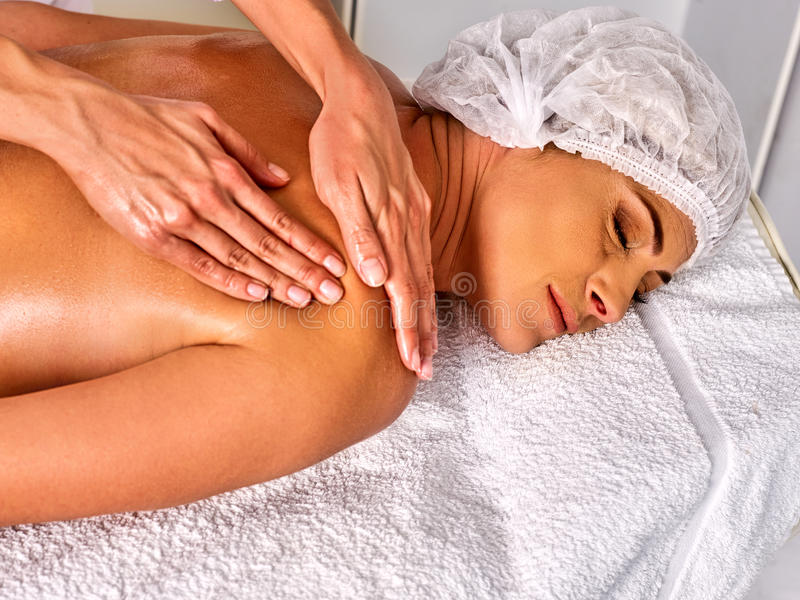 Massage therapy deals. Woman therapist making manual therapy back. Massage therapy in cosmetology spa centre. Woman therapist making manual therapy back. Hands royalty free stock photography