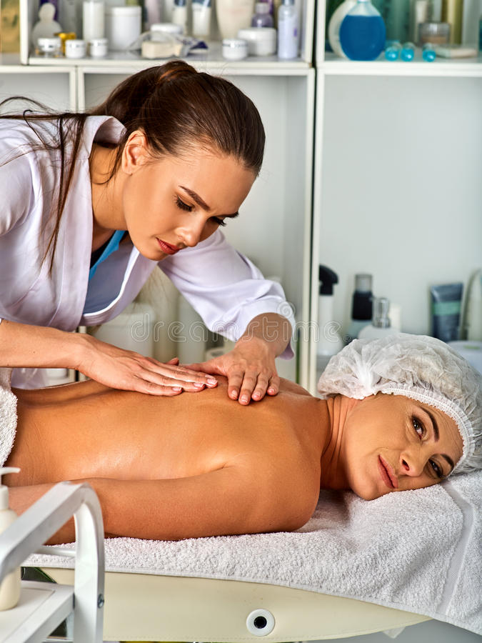 Massage therapy deals. Woman therapist making manual therapy back. Massage room for therapy deals. Woman therapist making manual therapy back. Hands of masseuse stock photos