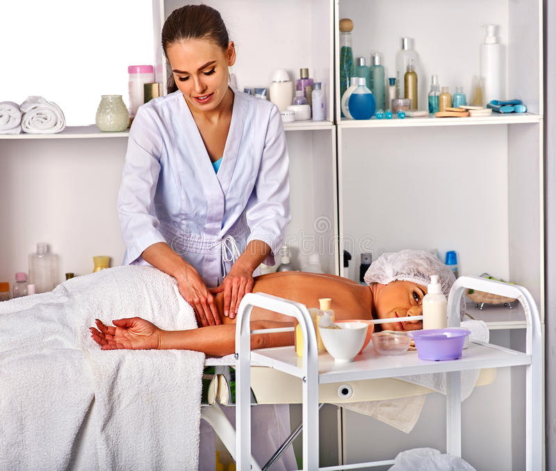 Massage therapy deals. Woman therapist making manual therapy back. Massage room for therapy deals. Woman therapist making manual therapy back. Hands of masseuse stock image