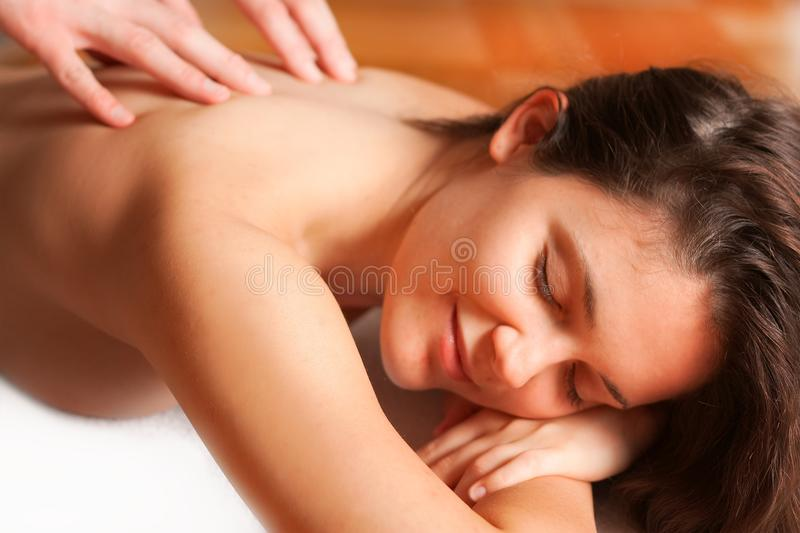 Massage treatment. Shot of massage treatment. Hands on woman's body royalty free stock photos