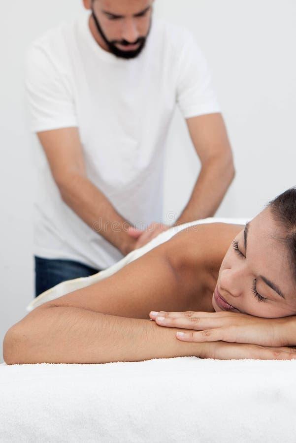 Massage treatment at spa stock photography