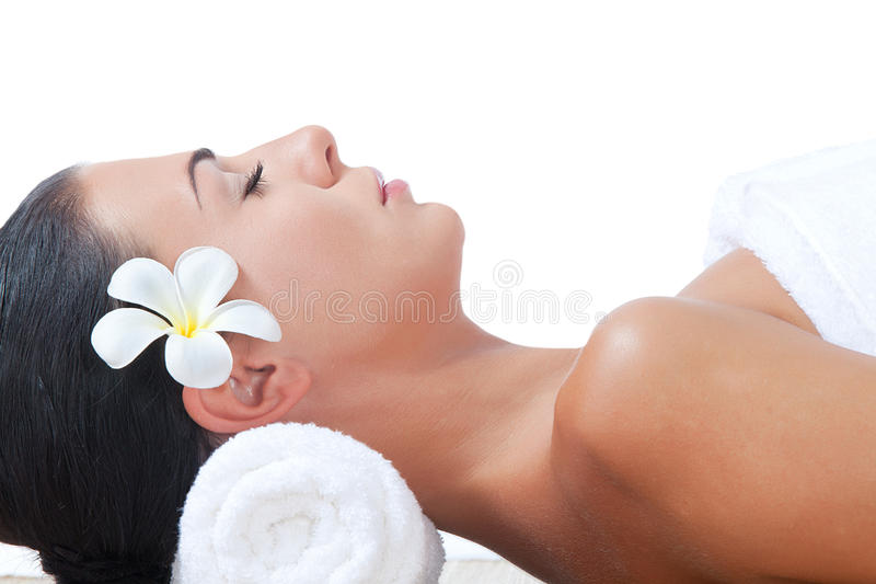 Massage on white. Portrait of young beautiful woman in spa on white back stock images