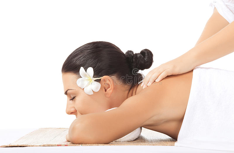Massage on white. Portrait of young beautiful woman in spa on white back royalty free stock photography
