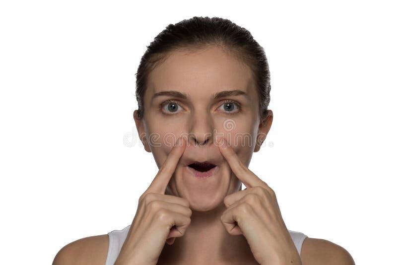 Massage, yoga, gymnastics or rejuvenating exercises for the face. Massage, yoga, gymnastics or rejuvenating exercises for the muscle of the face makes the girl stock photos
