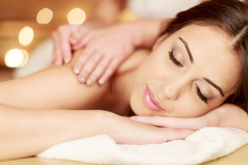 Massage. Young woman having a massage royalty free stock image