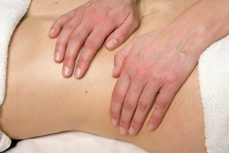 Massagem abdominal na região do rim fotografia de stock