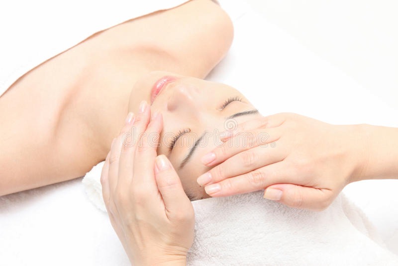 Massagem de face imagens de stock