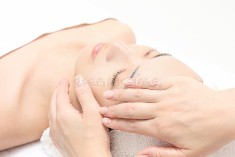Massagem de face foto de stock