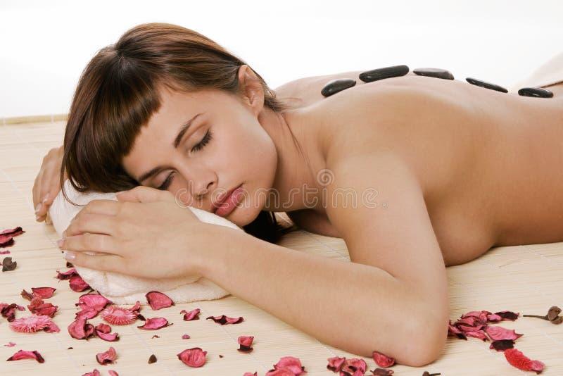 Massagem de pedra quente foto de stock royalty free
