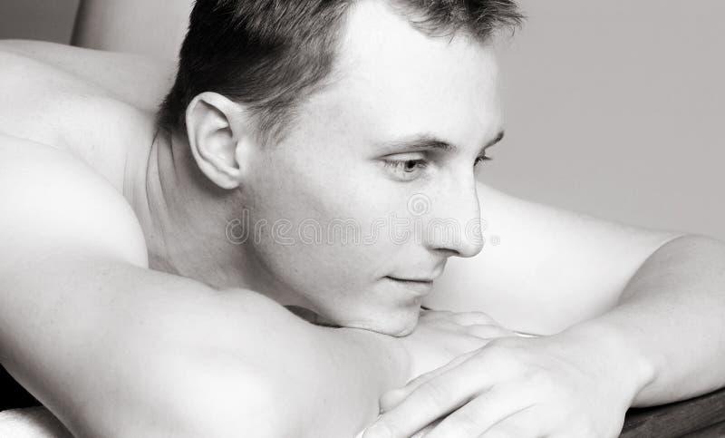 Massagem do homem novo fotografia de stock royalty free