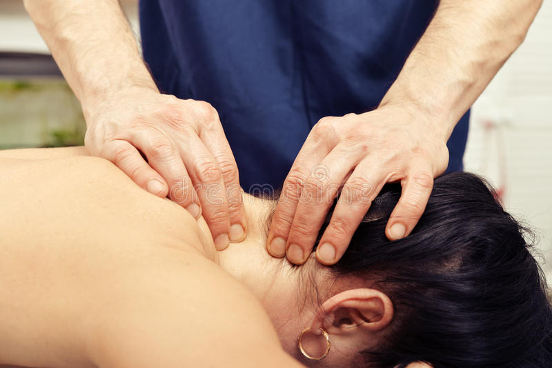 Massagem do pescoço imagem de stock royalty free