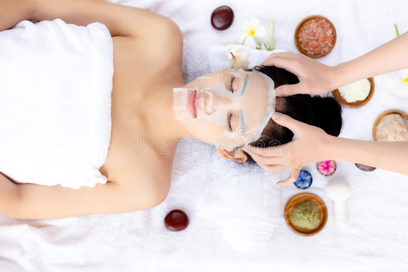 Massager massage on her head, make beautiful woman relieve stress from work and makes her feel relaxed. Attractive beautiful lady. Love massage, aromatherapy at stock photo
