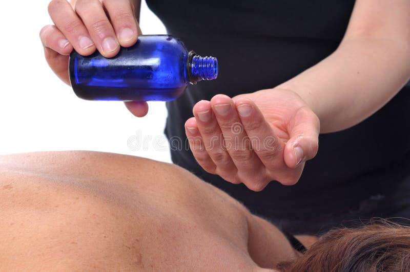 Massagetherapieschmieröl stockbild