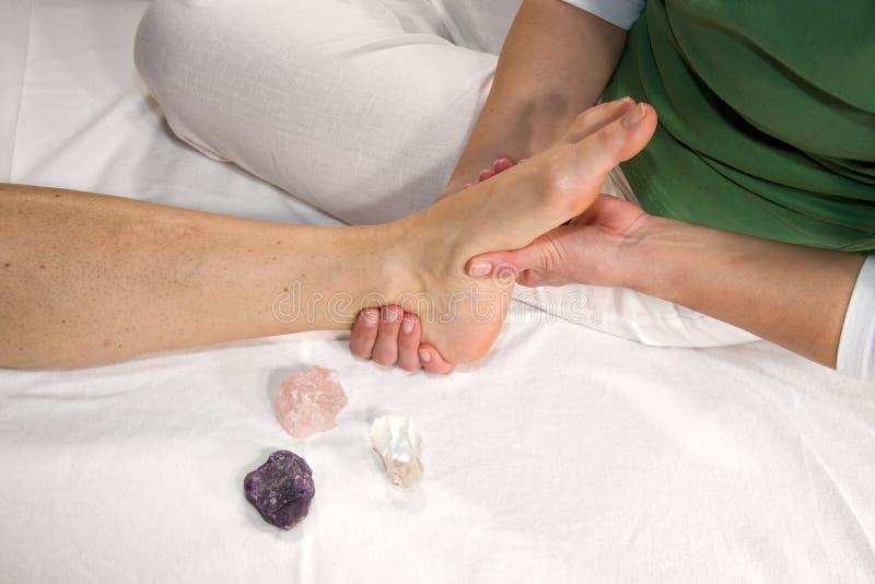 Massaggio riflesso di zona del piede fotografia stock