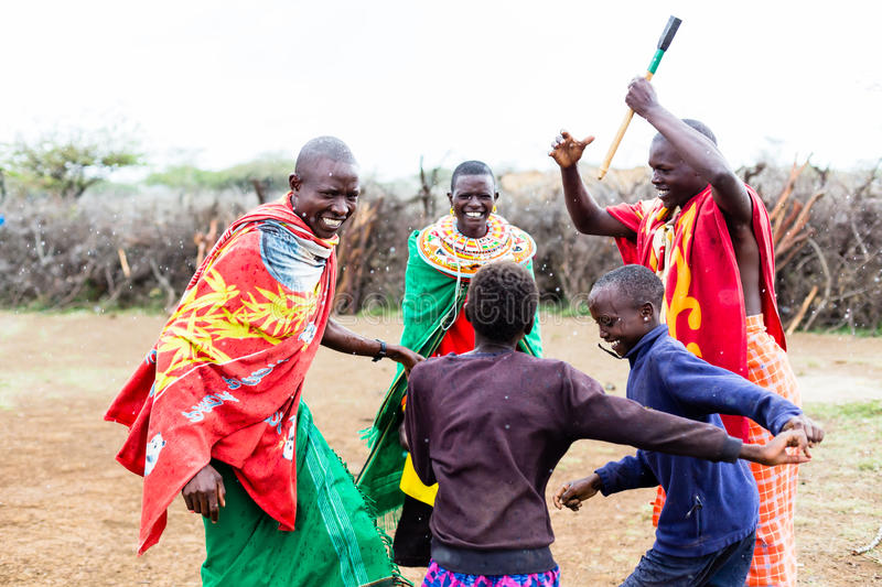 Massai family celebrating and dancing royalty free stock image