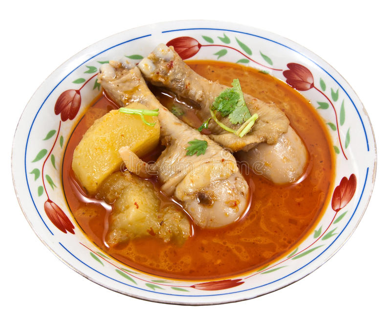 Massaman curry. A southern Thai dish. The dish usually contains coconut milk, roasted peanuts or cashews, potatoes, bay leaves, cardamom pods, cinnamon, star royalty free stock photography