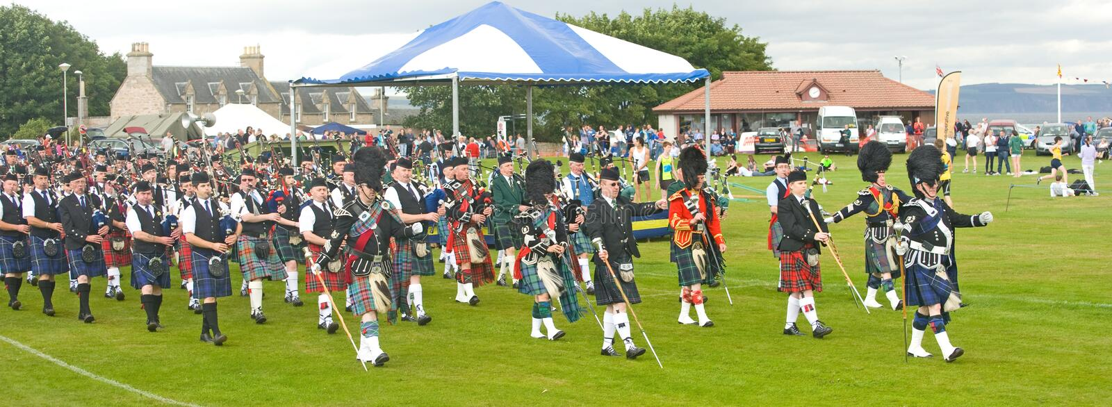 Massed Pipe bands marching at Nairn.
