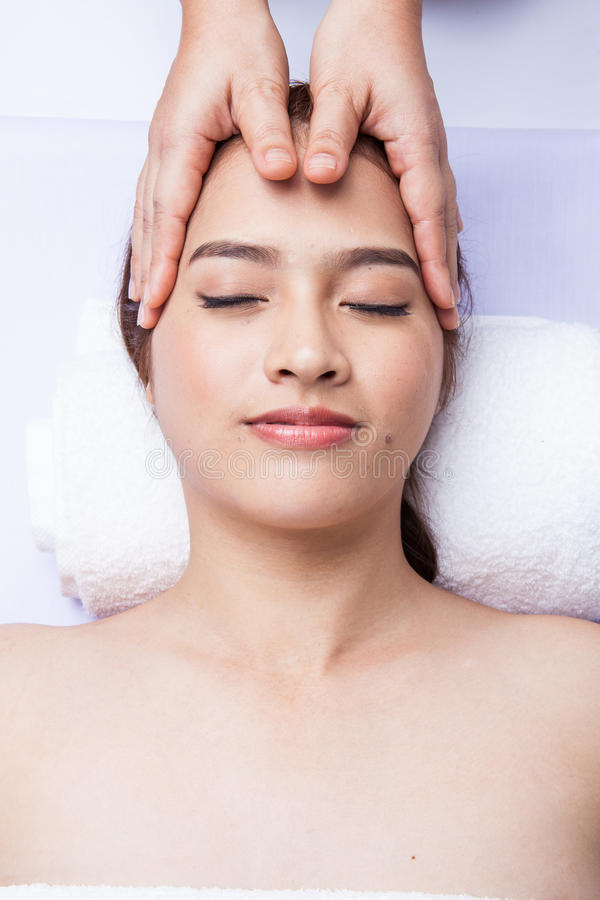 Masseur doing massage the head. royalty free stock image