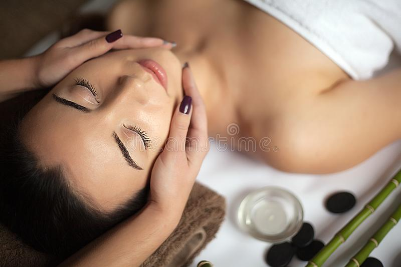 Masseur doing massage on woman body in the spa salon. Beauty treatment concept. royalty free stock photo