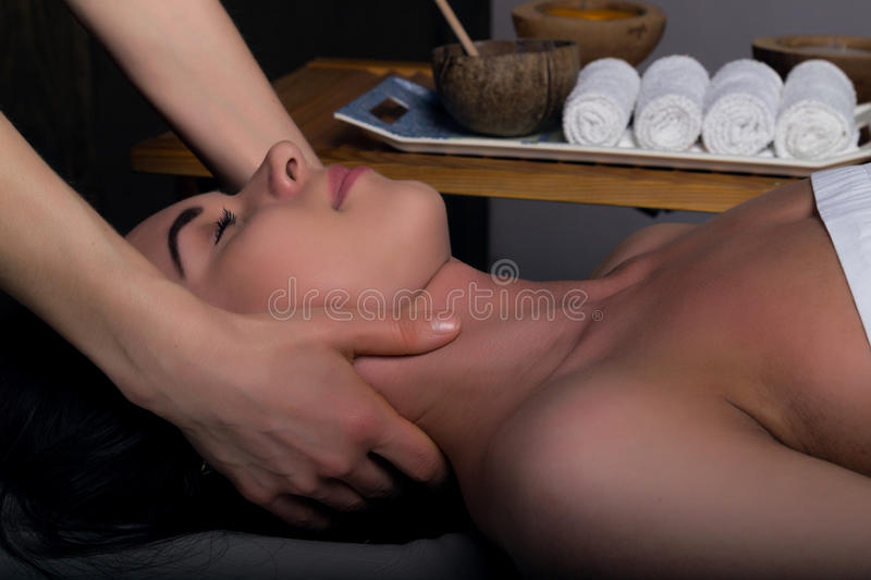 Masseur doing massage on woman body in the spa salon. woman relaxed. Beauty treatment concept royalty free stock photos