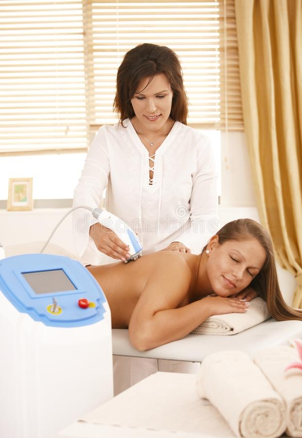Download Masseur Doing Radio Frequency Treatment Stock Image - Image: 23242213