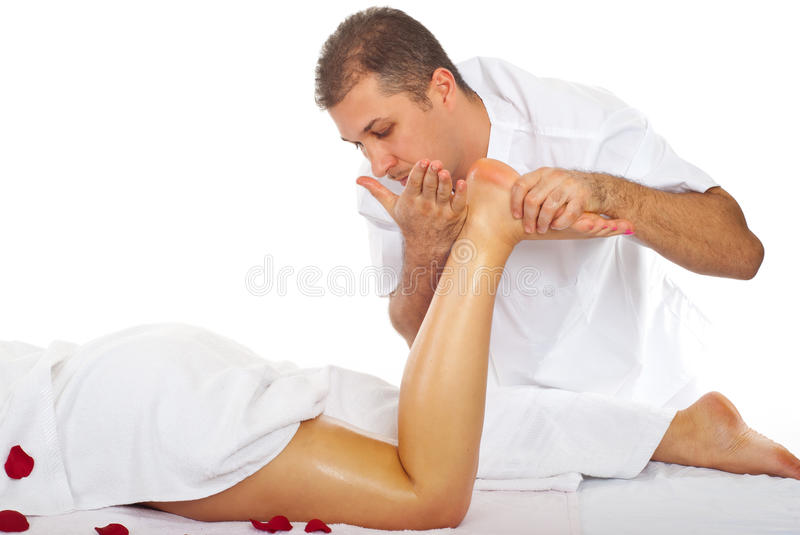 Masseur giving anti cellulite massage. To a woman legs in a spa salon royalty free stock image