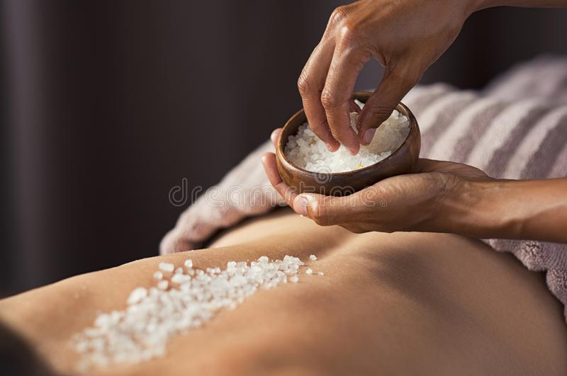 Body scrub with salt at spa stock photography