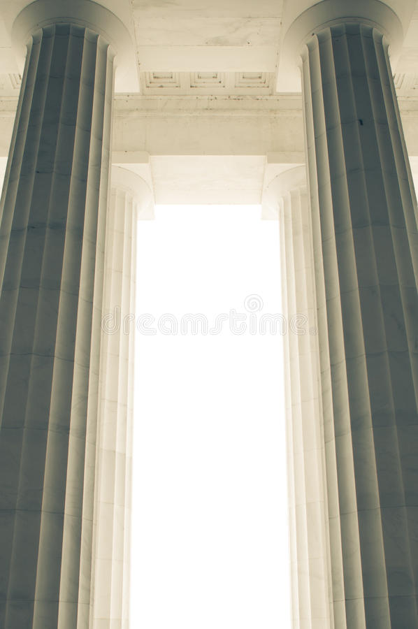 Massive architectural columns. Massive pillars supporting structure above all in white precast concrete royalty free stock image