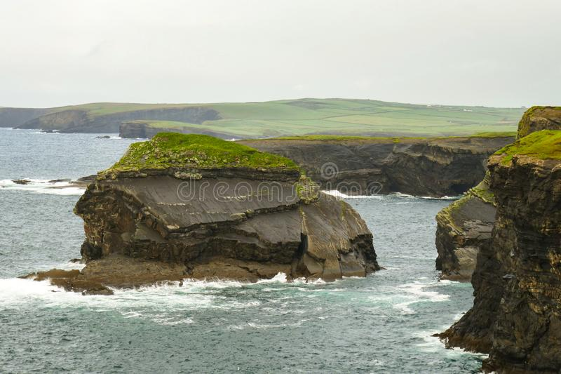 Massive awe-inspiring sea stack created by coastal erosion on Loop Head Peninsula, County Clare, Ireland. stock image