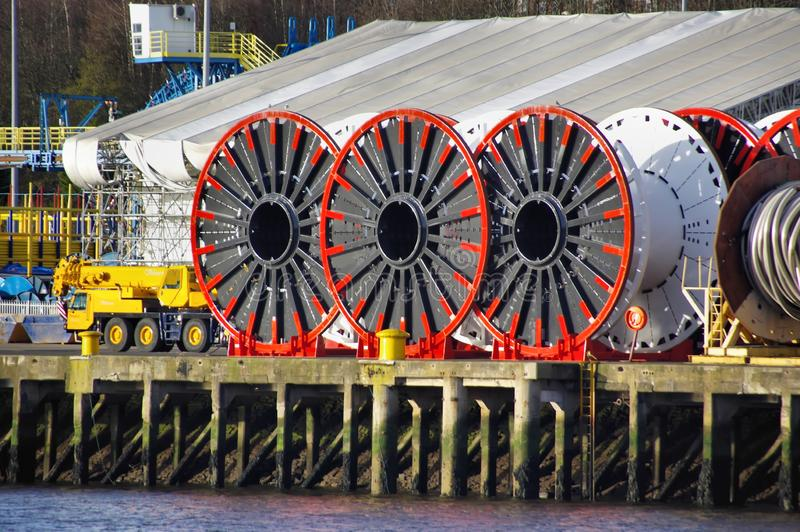 Massive Cable Spools for Sub Sea Cables. Giant metal cable reels on the banks of the river Tyne used to hold submarine telecommunication and power cables for stock photos