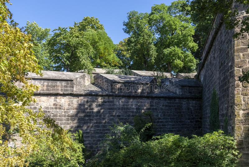 Massive and huge Nuremberg city wall around the castle garden or large bastion at the Imperial Castle with many trees. Nuremberg with a beautiful medieval city royalty free stock photos