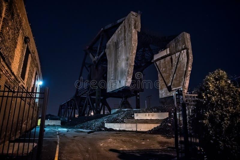 Massive industrial Bascule railroad train bridge at night. stock image