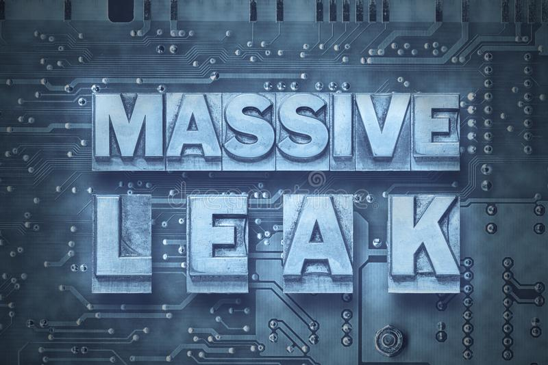 Massive leak pc board. Massive leak phrase made from metallic letterpress blocks on the pc board background stock photos