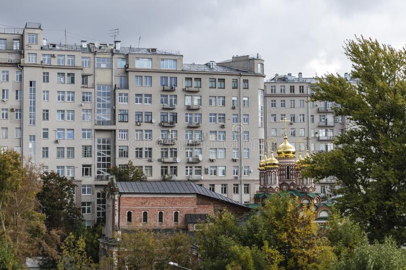 Massive residential building with orthodox church and park on a typical Moscow cityscape building royalty free stock images