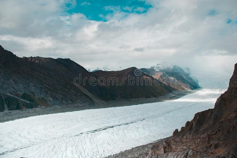 The massive root glacier pouring down toward Kennecott from Mount Regal stock photo